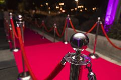 Red carpet. Long red carpet between rope barriers on VIP entrance Royalty Free Stock Image