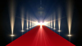 Long red carpet with spotlights