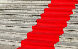 long red carpet on the wide steps of historic building Royalty Free Stock Image