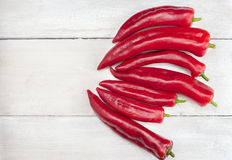 Long red fresh pepper,paprika ,old white wooden table Stock Photo