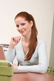 Long red hair business woman at office Stock Image