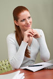 Long red hair woman thinking at office Royalty Free Stock Images