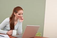 Long red hair woman working at office with coffee Royalty Free Stock Photography