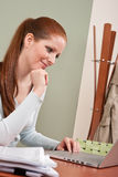 Long red hair woman working at office with laptop Royalty Free Stock Photo