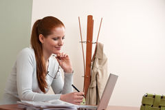 Long red hair woman working at office with laptop Stock Photo