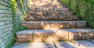 Long red stone staircase steps made out of big granite stone blocks old retro style background texture. Along red stone staircase steps made out of big granite stock photos