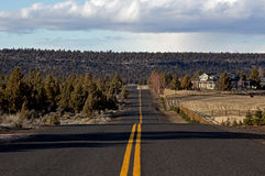 Long Rippled Country Road. A long wavy rippled country blacktop road royalty free stock image