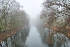 Long river disappearing in fog Royalty Free Stock Image
