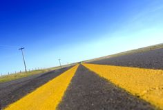 Long road. A long stretching rural road royalty free stock photography