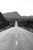 Long road. Through mountains, black and white image Stock Images