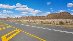 Long road through African karoo land Stock Photo