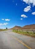 Long road through African karoo land Royalty Free Stock Image