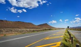 Long road through African karoo land Stock Photos