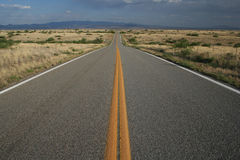 Long road ahead. A country road through southeastern Arizona Royalty Free Stock Photo