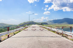 Long road ahead. Mountain. Blue sky. White clouds. Stock Image