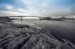 Long road bridge. Beautiful Norway landscape. Lofoten islands. Black-white photo with blue sky. Royalty Free Stock Photo