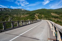 Long road on the bridge in the mountains Stock Image