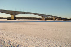 Long road bridge. Over the frozen river Royalty Free Stock Photo