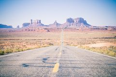 A long road in Death Valley Arizona. A road runs into the hills of Sedona Monument Valley in Death Valley Arizona royalty free stock image