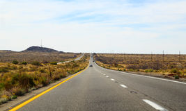Long road through the desert Royalty Free Stock Photos
