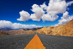Long road in desert and blue sky background Royalty Free Stock Photography
