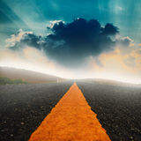 Long road and dramatic sky with sunray Stock Images