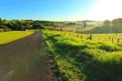 Long road into the hilly area Stock Photo