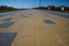 Long road lined with tiles.  Background. Long road lined with tiles Royalty Free Stock Photo