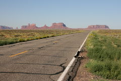 Long road into Monument Valley. Royalty Free Stock Images