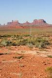 Long road into Monument Valley. Royalty Free Stock Photo