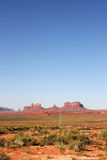 Long road into Monument Valley. Royalty Free Stock Photos
