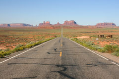 Long road into Monument Valley. Royalty Free Stock Image
