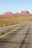 Long road into Monument Valley. Stock Photography