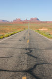 Long road into Monument Valley. Stock Photos