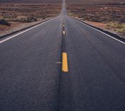 Long road at monument valley Stock Images