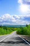 Long road in noth green hills. The long noth asphalt road in green hills Royalty Free Stock Image