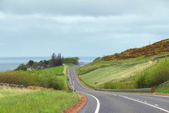 Long road with ocean view Stock Photography