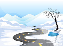 A long road at the snowy place going to the mountains Royalty Free Stock Image