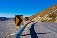 Long road stretching out to dry mountain Stock Image