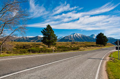 Long road stretching out to dry mountain Royalty Free Stock Photo
