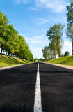 Long road to green hills. Royalty Free Stock Photography