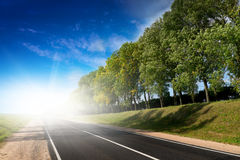 Long road to green hills. Stock Photography