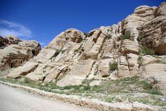 The long road to Petra. Jordan. The long, hot road in the ancient city of Petra. Jordan. The road runs between the rocks and through narrow gorges. Ancient Royalty Free Stock Images