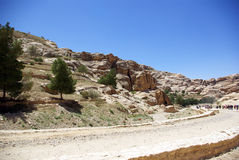 The long road to Petra. Jordan. The long, hot road in the ancient city of Petra. Jordan. The road runs between the rocks and through narrow gorges. Ancient Stock Photo