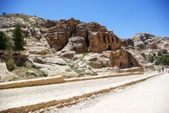 The long road to Petra. Jordan. The long, hot road in the ancient city of Petra. Jordan. The road runs between the rocks and through narrow gorges. Ancient Stock Images