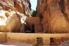The long road to Petra. Jordan. The long, hot road in the ancient city of Petra. Jordan. The road runs between the rocks and through narrow gorges. Ancient Stock Photos
