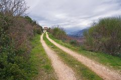 Long road to small village church. Montenegro Royalty Free Stock Photos