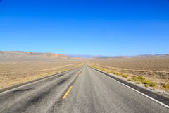 The long road to somewhere. The long straight isolated, lonely road to somewhere Stock Photo
