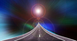 Long road up to high with lens flare light on colourful spectrum. And dark background stock images