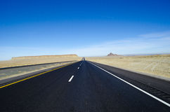 Long road Utah. Long black road Monument Valley stock images
